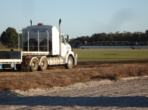 Truck and irrigation watering at Wonnerup Turf Farm